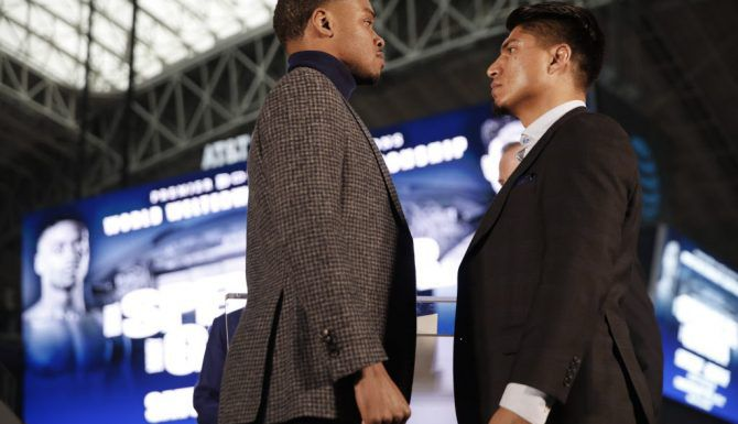 Boxers Errol Spence Jr. (left) and Mikey Garcia face off for photos during a press conference for the Premier Boxing Champions fight between Unbeaten IBF Welterweight World Champion Errol Spence Jr. and undefeated four-division world champion Mikey Garcia at AT&T Stadium on Tuesday, Feb. 19, 2019. The match will take place at AT&T Stadium on March 16, 2019.  (Rose Baca/Staff Photographer)