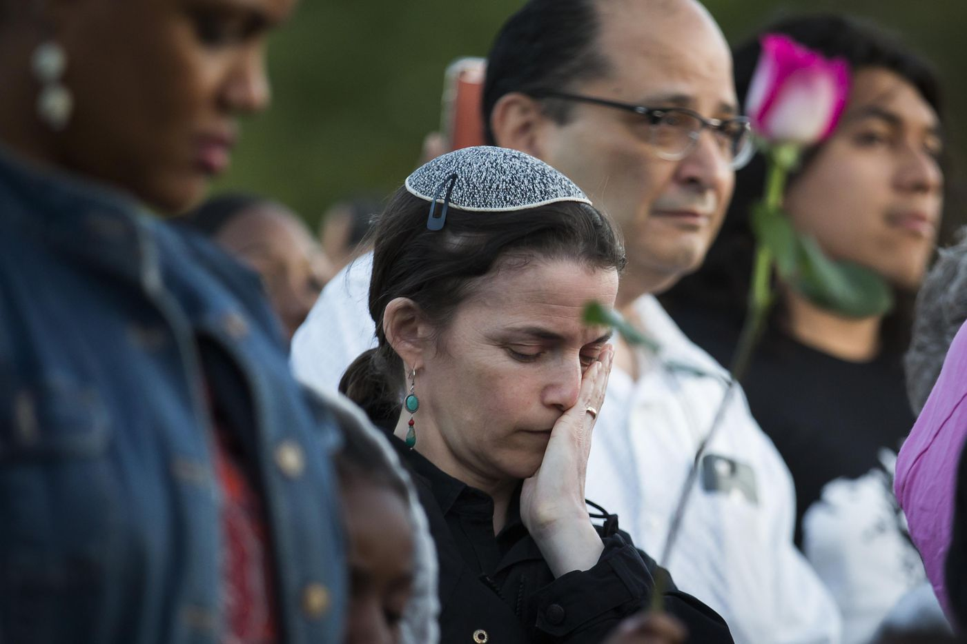 """Rabbi Elana Zelony bows her head during the """"Remember His Name: Vigil for Jordan Edwards"""" candlelight vigil at Virgil T. Irwin Park on Thursday, May 4, 2017, in Balch Springs, Texas."""