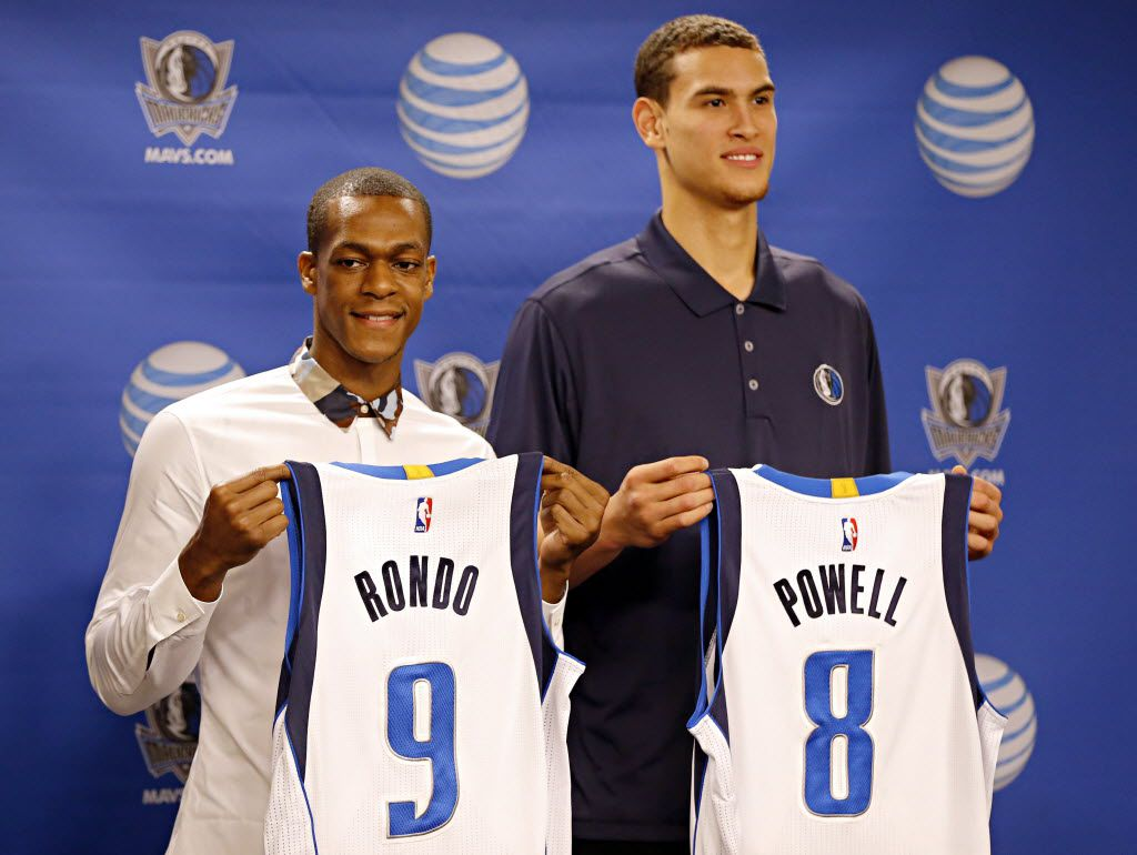 Rajon Rondo (left) and Dwight Powell hold their new Dallas Mavericks jerseys during a press conference at the American Airlines Center December 19, 2014 in Dallas, Texas. (G.J. McCarthy/The Dallas Morning News) / mug - mugshot - headshot - portrait / 12202014xSPORTS 01022015xSPORTS 01232015xSPORTS