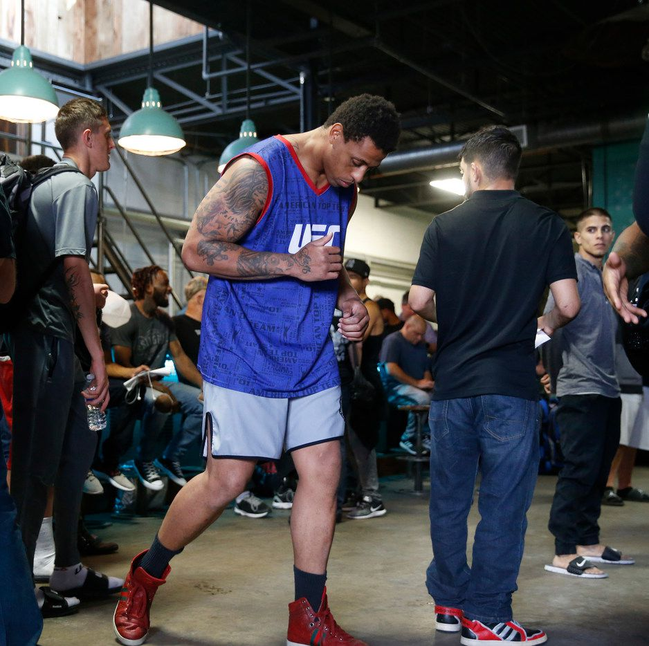 Former Dallas Cowboy Greg Hardy dances around while waiting in lie for paperwork at Deep Ellum Distillery in Dallas on Feb. 15, 2018.  Hardy is fighting in an amateur mixed martial arts heavyweight bout on Feb. 16. (Nathan Hunsinger/The Dallas Morning News)