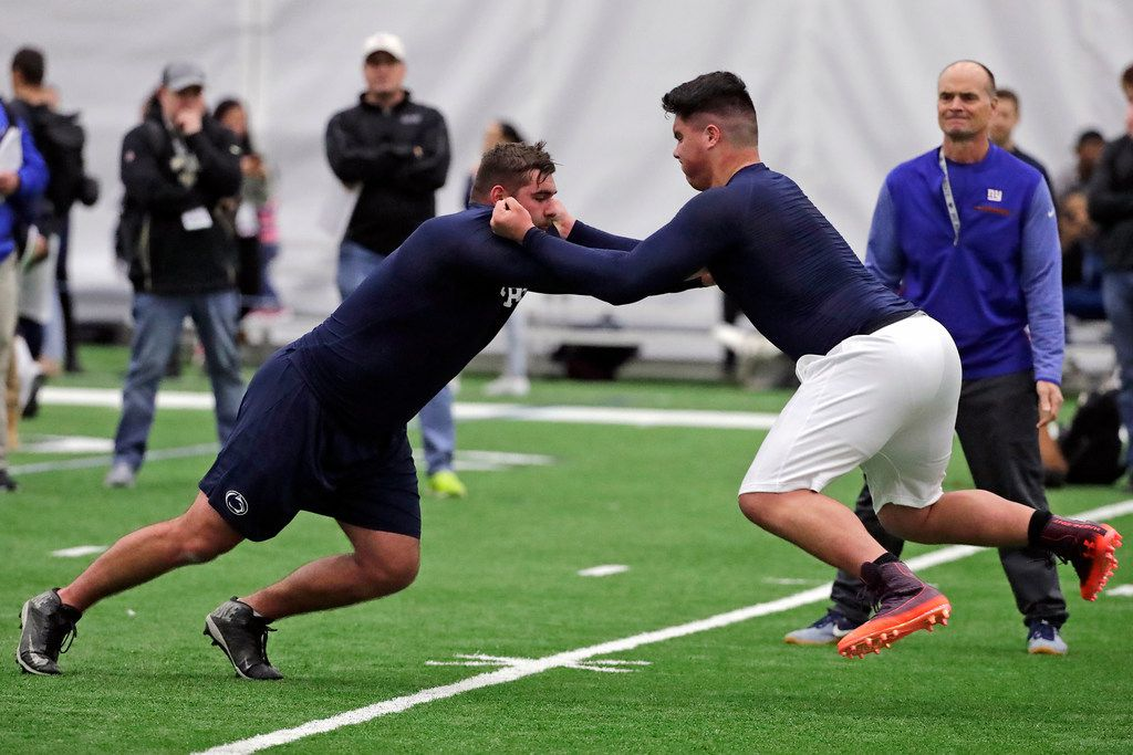 Penn State offensive linemen Connor McGovern, left, and Ryan Bates run a drill during Penn State's Pro Day in State College, Pa., Tuesday, March 19, 2019. (AP Photo/Gene J. Puskar)