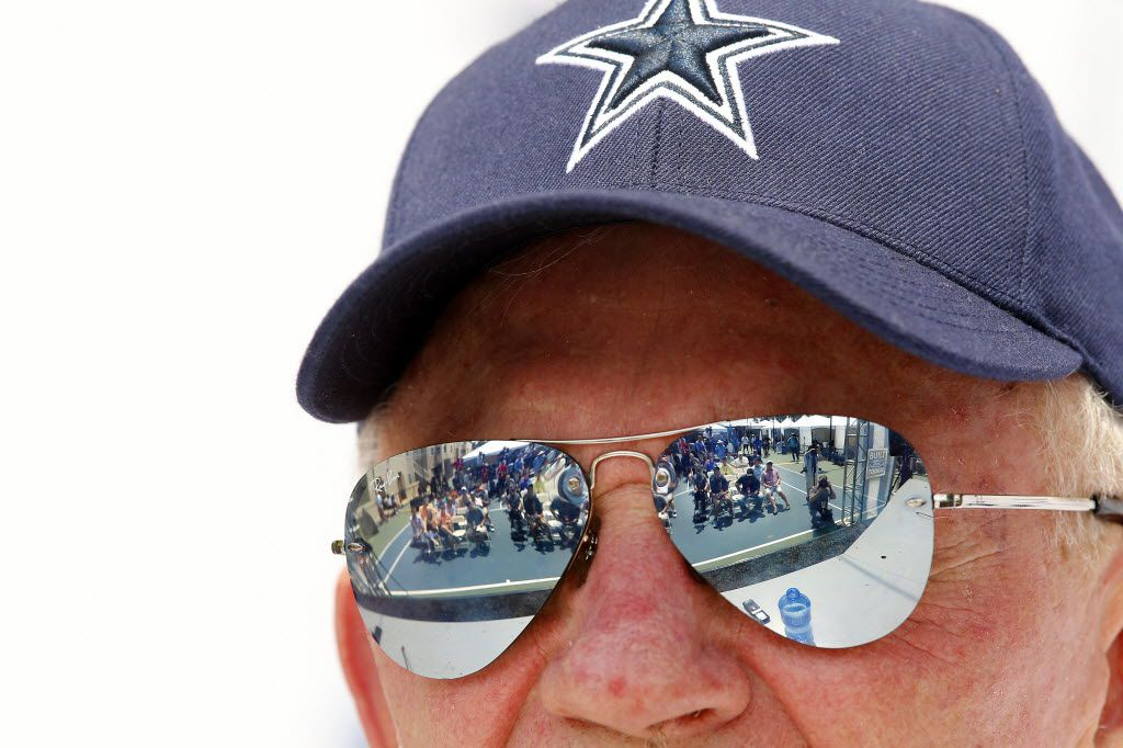 The media assembled for the Dallas Cowboys State of the Union address are reflected in owner Jerry Jones' Ray Ban sunglasses.  The Cowboys open this years training camp in Oxnard, California, Friday, July 29, 2016. (Tom Fox/The Dallas Morning News)