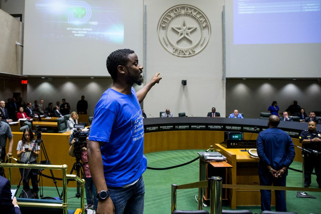 """Activist Dominique Alexander, leading a protest at a Dallas City Council meeting in September, called for giving the Citizens Police Review Board more power. Alexander said a stronger board is needed because """"it gives the taxpayers a voice in the Police Department that serves them."""""""