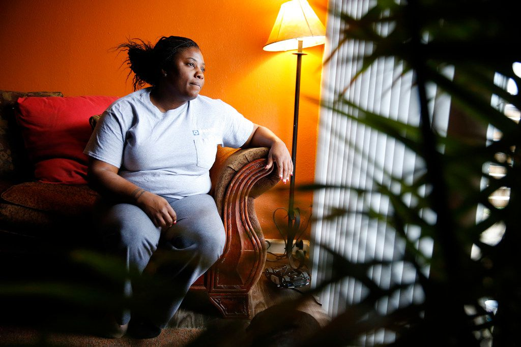 Jamietris Jones, a single mother of four, said she's still trying to get her life on track after speaking out about the sexual harassment she faced at her rail yard job. She poses for a photograph in her Dallas apartment, Friday, March 23, 2018.