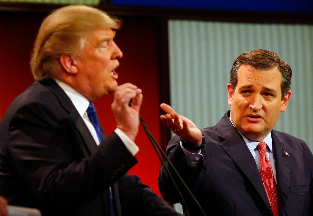 Donald Trump and Sen. Ted Cruz argue a point during a Republican presidential primary debate at Fox Theatre on  March 3, 2016, in Detroit.