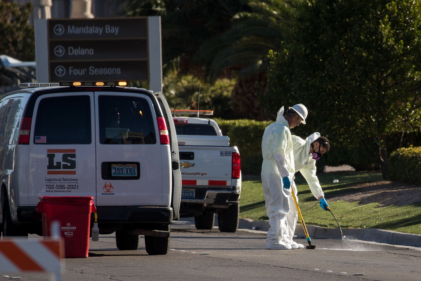 LAS VEGAS, NV - OCTOBER 3: Hazardous material clean-up workers scrub the street on Las Vegas Blvd. outside the Route 91 Harvest Festival grounds, October 3, 2017 in Las Vegas, Nevada.  Late Sunday night, a lone gunman killed over 50 people and injured over 500 people after he opened fire on a large crowd at the Route 91 Harvest country music festival. The massacre is one of the deadliest mass shooting events in U.S. history. (Photo by Drew Angerer/Getty Images)