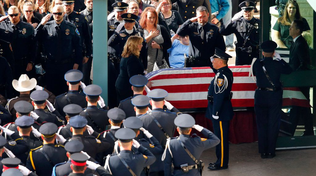 The casket of Little Elm police detective Jerry Walker is rolled from the funeral service to the hearse at Prestonwood Baptist Church in Plano on January 24, 2017. Walker was fatally shot during a standoff with a barricaded man.