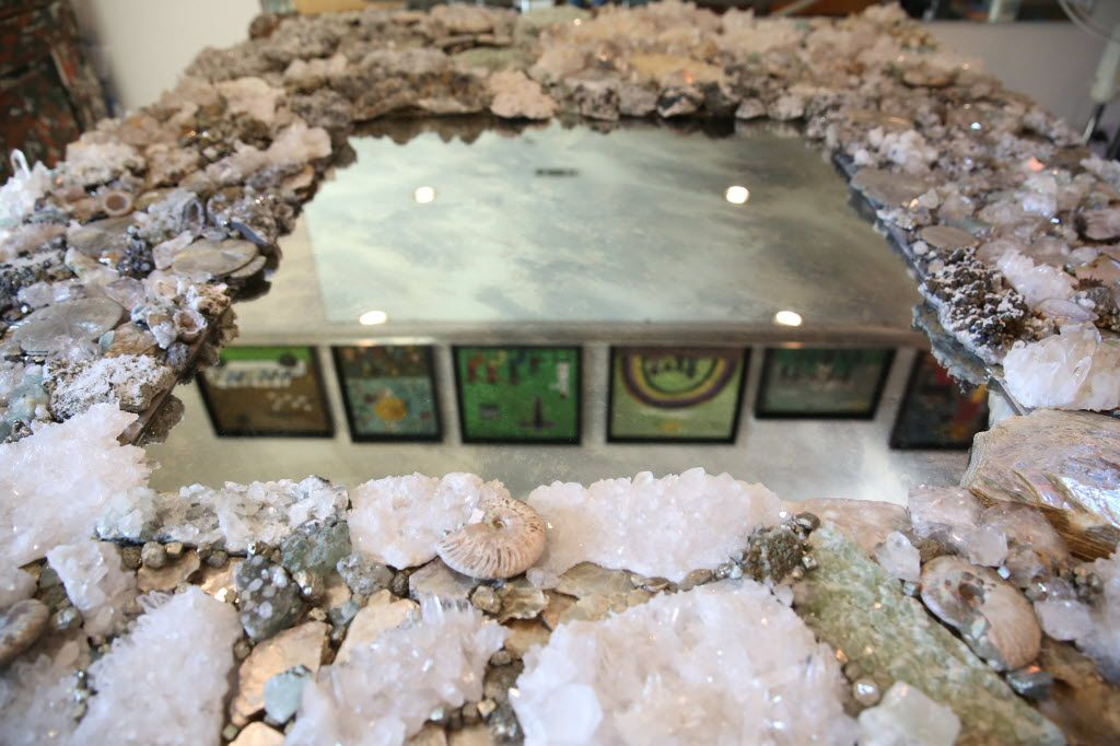 A large mirror of rocks and minerals made by Connie Chantilis