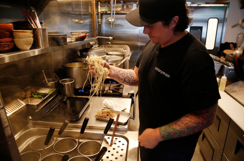 Chef Justin Holt prepares to cook noodles that took four days to make and age.