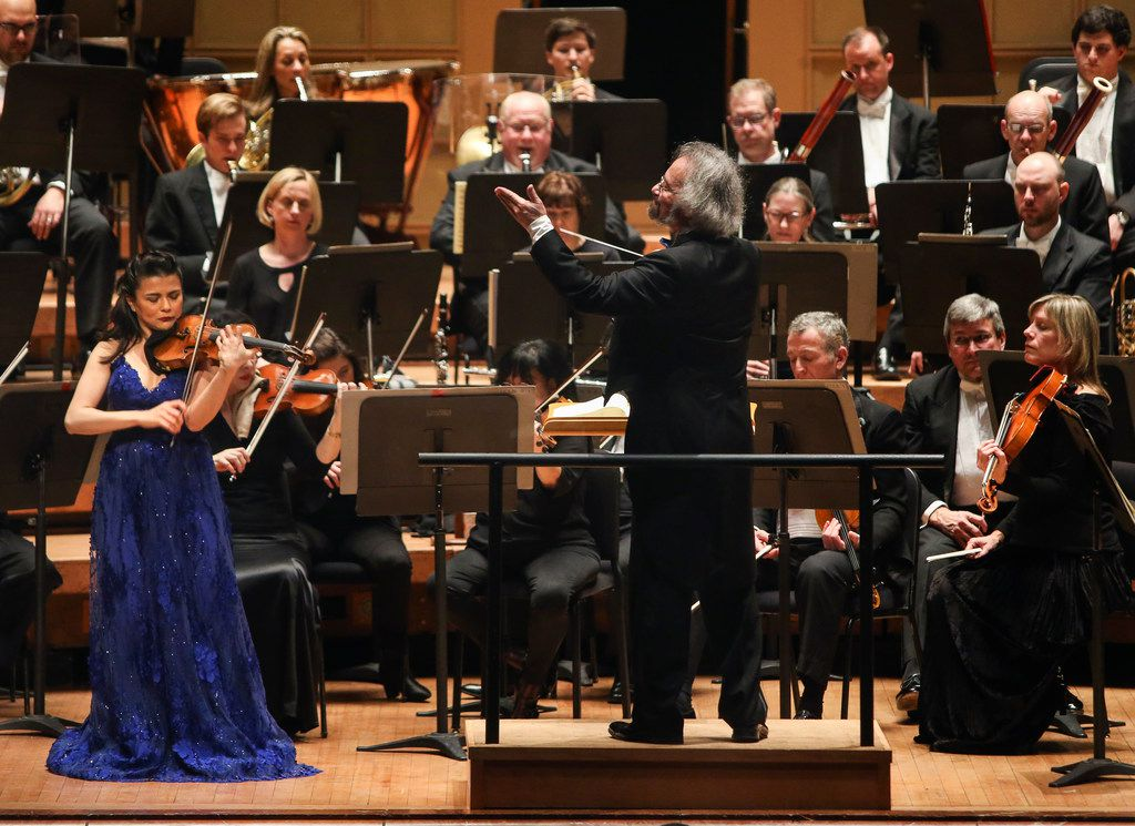 Conducted by Carlos Kalmar, violin soloist Karen Gomyo, left, performs with the Dallas Symphony Orchestra concert on Thursday, Feb. 28, 2019 at the Meyerson Symphony Center in Dallas. (Ryan Michalesko/The Dallas Morning News)