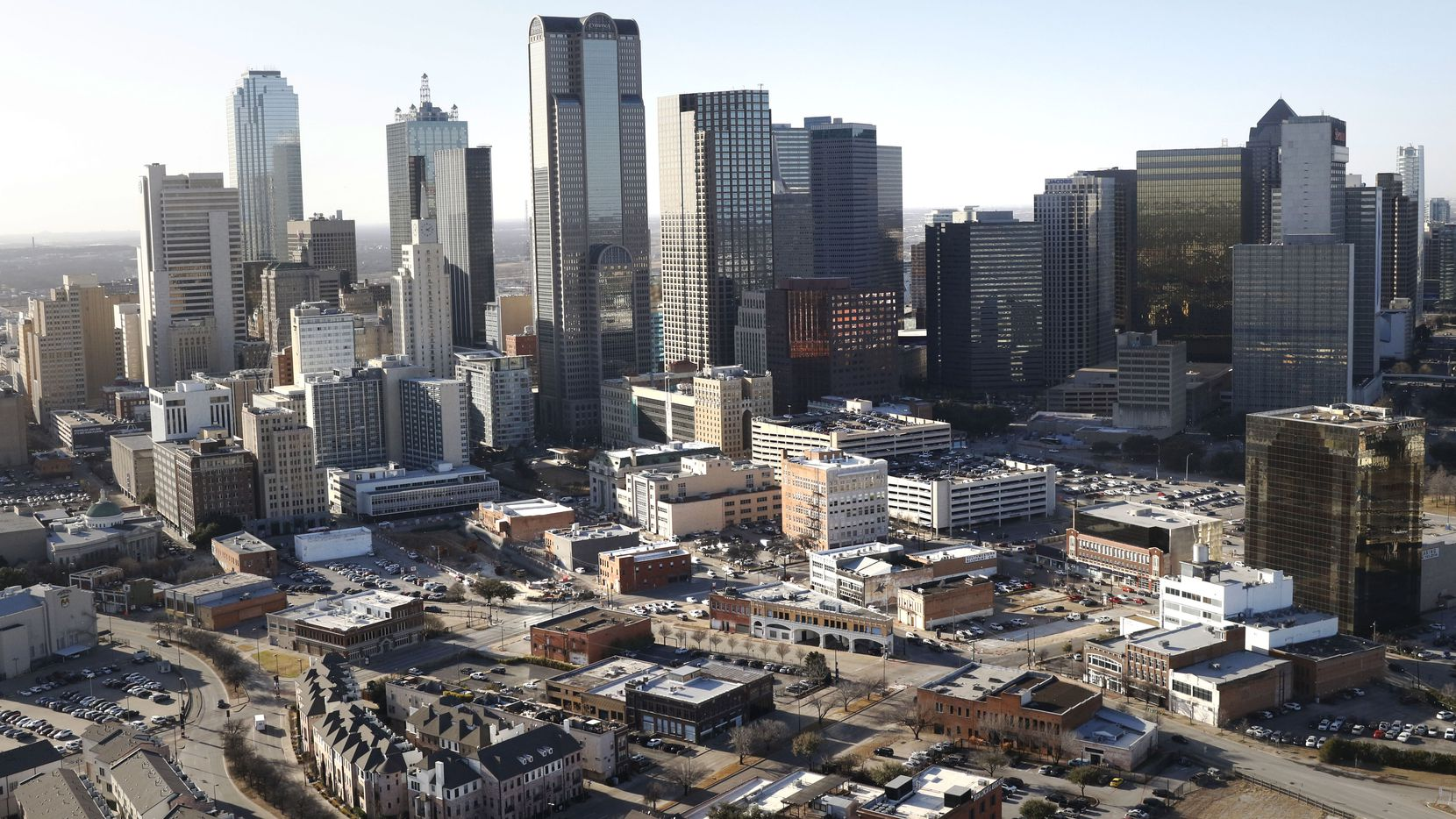 A partnership headed by Dallas' Todd Interest is buying up almost two dozen buildings and land on the eastern edge of downtown Dallas.