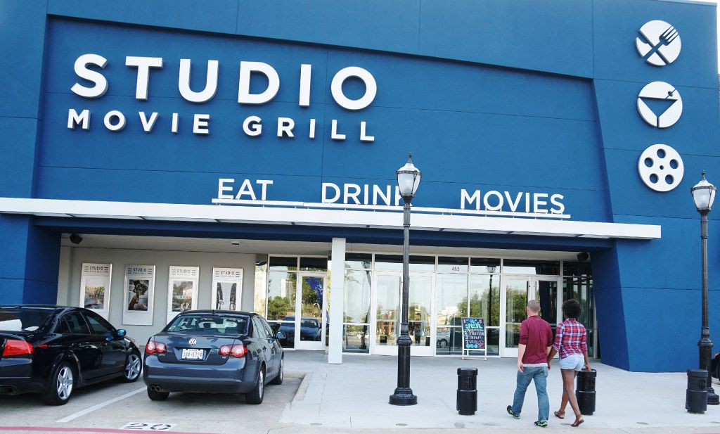 Moviegoers head into Studio Movie Grill in Arlington, Texas, on Aug. 31, 2017. The nine-screen theater opened in January.