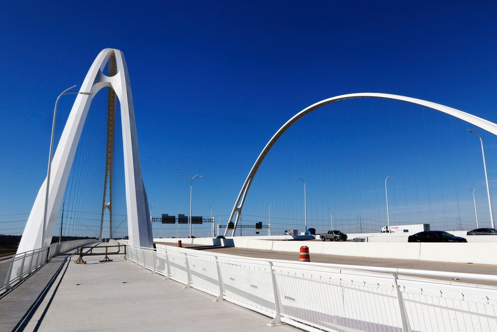 Cables and arches rise over the pedestrian and bike lane of the Margaret McDermott Bridge, which spans the Trinity River on I-30 in Dallas.