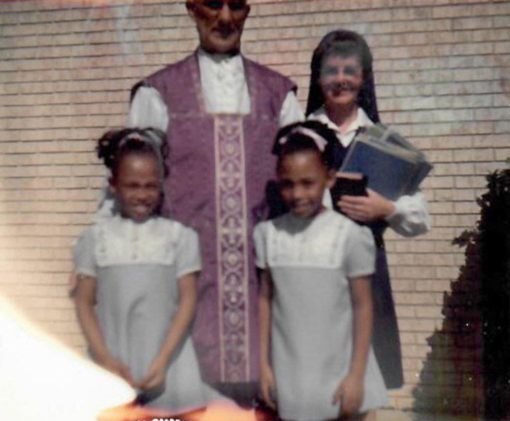 Micaela (left) and Myrna Dartson, age 9, with Bishop Thomas Tschoepe and an unidentified nun.
