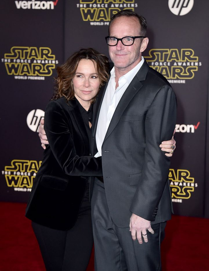"""Jennifer Grey, left, and Clark Gregg arrive at the world premiere of """"Star Wars: The Force Awakens"""" at the TCL Chinese Theatre on Monday, Dec. 14, 2015, in Los Angeles."""