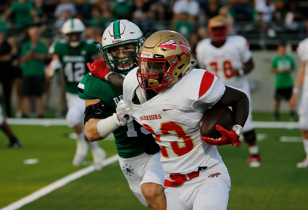 Southlake's Brandon Howell (15) tackles South Grand Prairie's Javarius Crawford (23) during the first half of their high school football game in Southlake Texas on August 30, 2019. (Michael Ainsworth/Special Contributor)