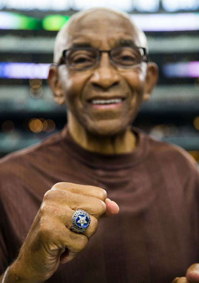 Former Dallas Cowboys player Pettis Norman holds up his Super Bowl ring from 1970 before an NFL football game between the Los Angeles Rams and the Dallas Cowboys on Sunday, October 1, 2017 at AT&T Stadium in Arlington, Texas. (Ashley Landis/The Dallas Morning News)