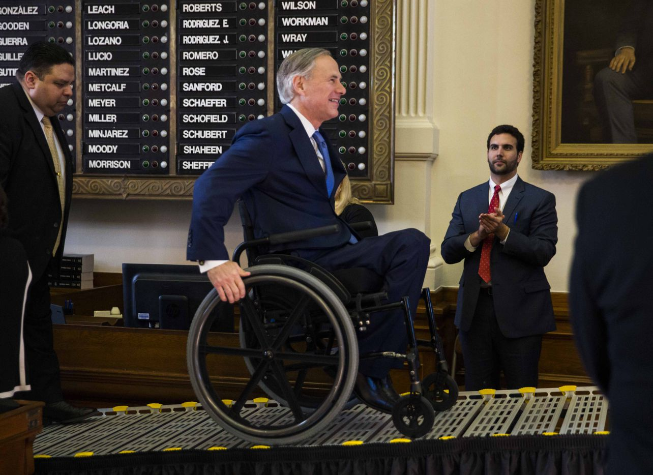 Texas Gov. Greg Abbott makes his way to the podium in the House of Representatives during the first day of the 85th Texas Legislative Session on Tuesday at the Texas State Capitol in Austin.