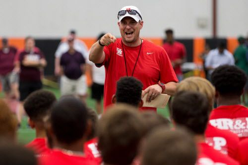 University of Houston football head coach Tom Herman make an announcement to the high school students during a football satellite camp jointly hosted by Texas A&M and University of Houston at Lancaster High School on June 9, 2016 in Lancaster, Texas. (Ting Shen/The Dallas Morning News)