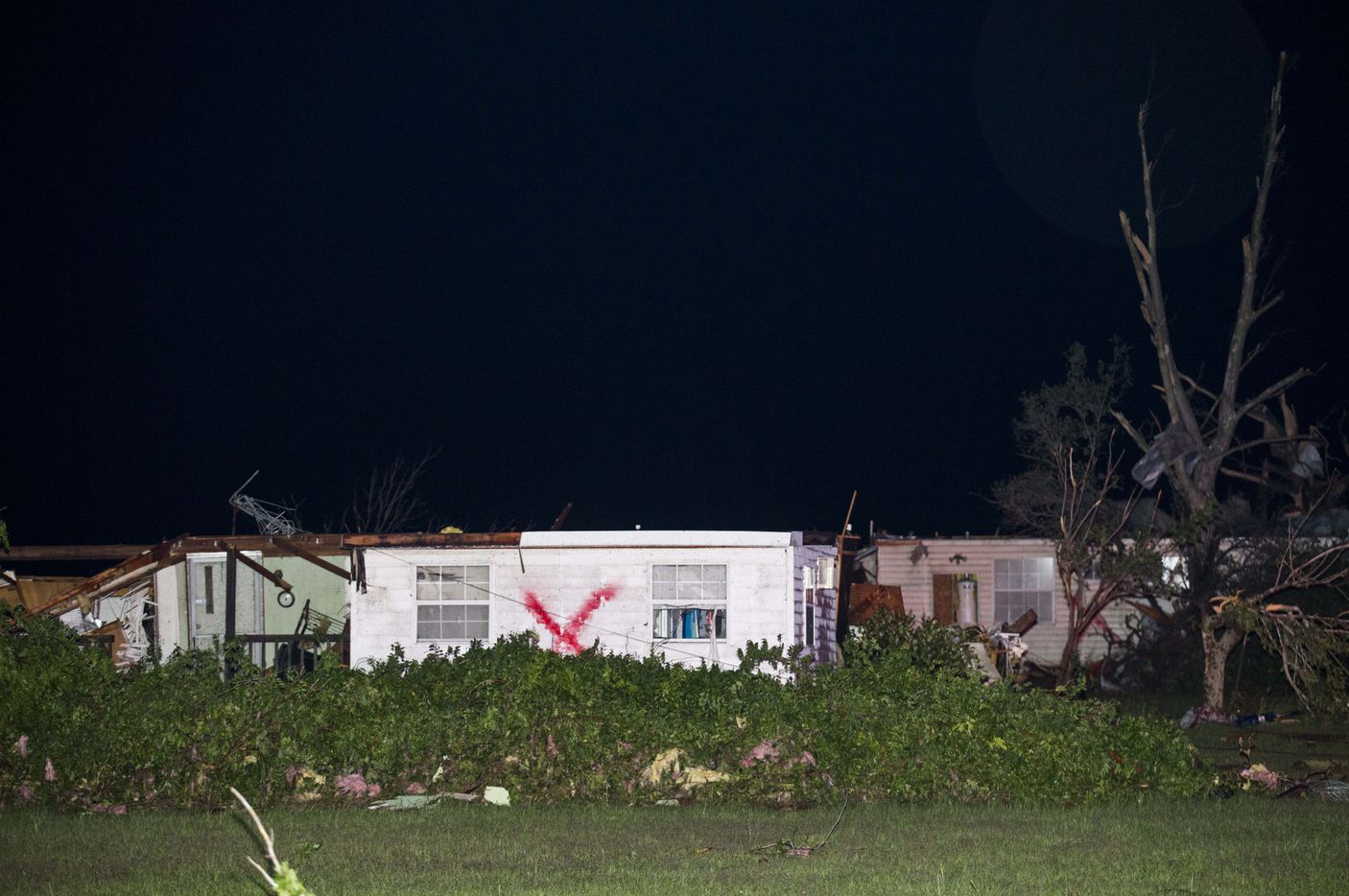 Damaged homes sit in the dark near FM 19 south of Canton, Texas  (Ashley Landis/The Dallas Morning News)