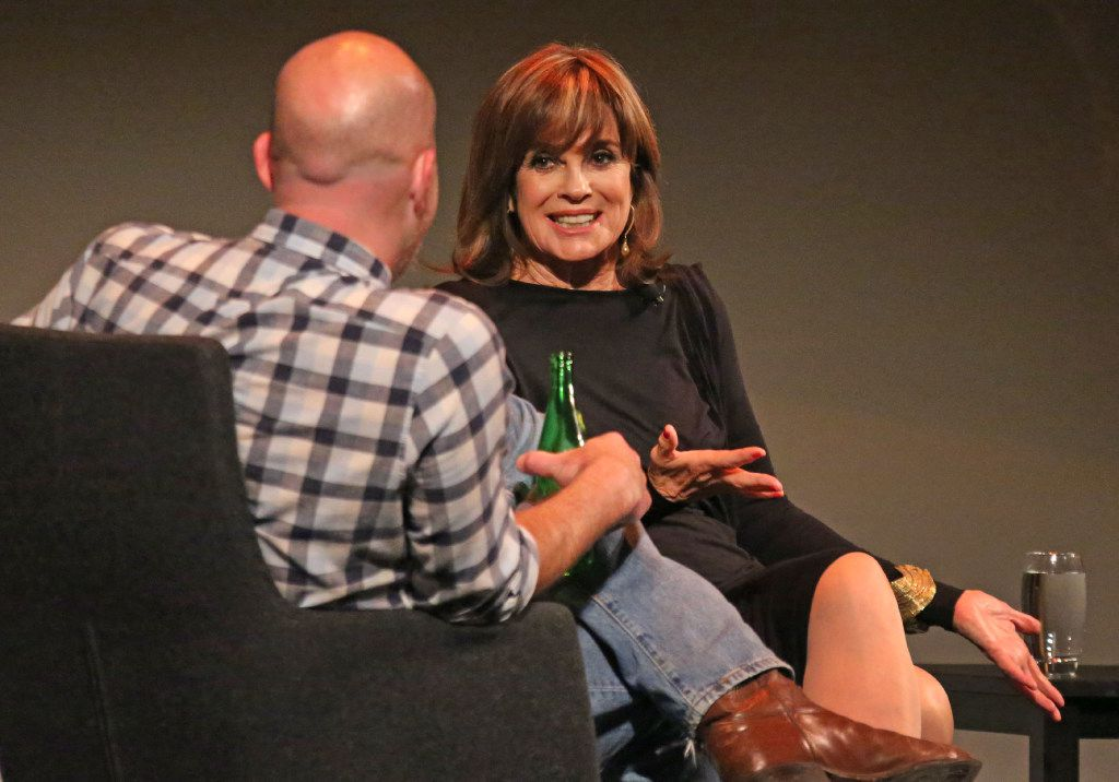 "Dallas Morning News columnist Robert Wilonsky talks with Linda Gray at ""A Dallas Retrospective: J.R. Ewing Bourbon Presents Linda Gray and Patrick Duffy,""  at the Winspear Opera House in Dallas. (Louis DeLuca/The Dallas Morning News)"