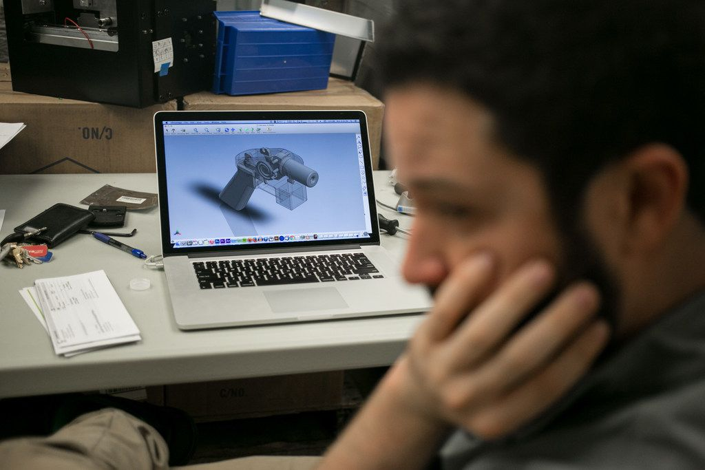 Cody Wilson with 3-D printer gun plans in Austin on May 4, 2015. Wilson is engaged in a legal fight to distribute plans for printing 3-D weapons. (Ilana Panich-Linsman/The New York Times)