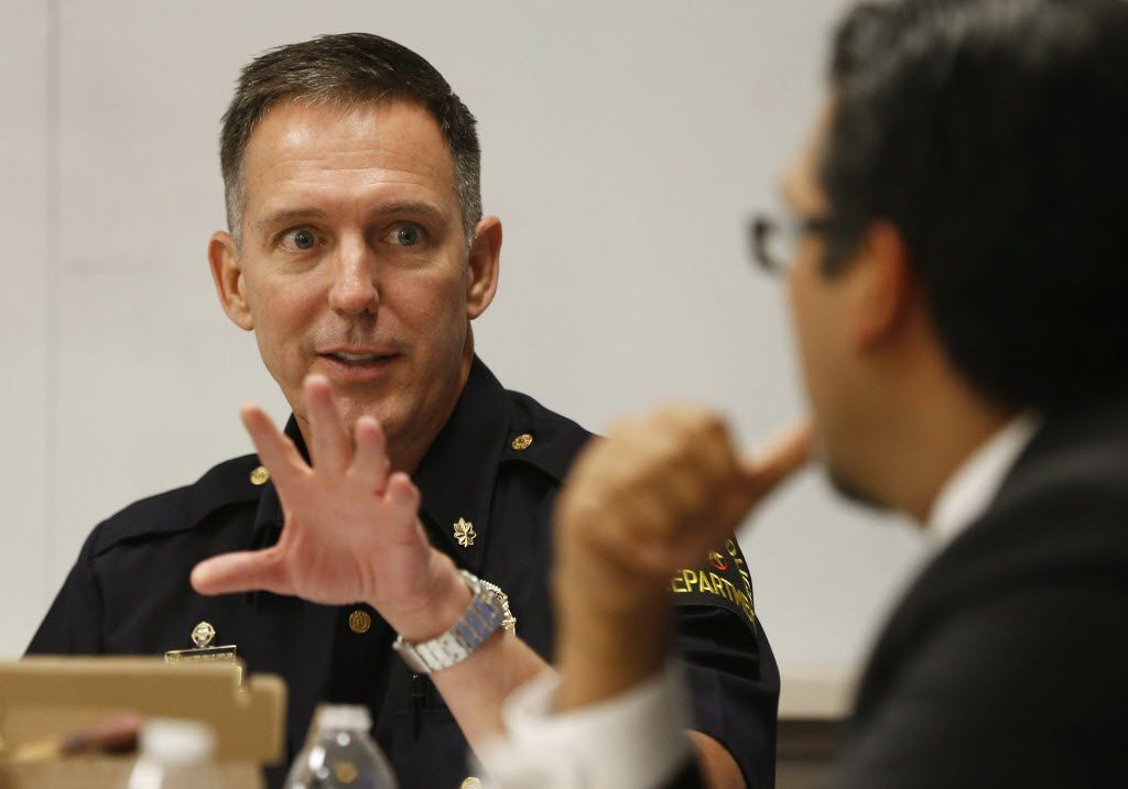 Robert Sherwin, who is now a Dallas police deputy chief, talks to Dallas county criminal court 10 judge Roberto Canas during a meeting about getting guns out of the hands of domestic abusers at the Family Place in Dallas, Texas on Friday, June 20, 2014. (Vernon Bryant/The Dallas Morning News)