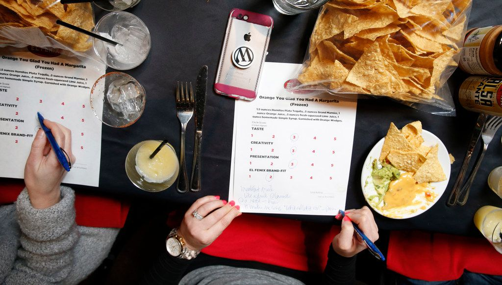 Judges write up scores during the margarita taste test at El Fenix in Dallas on Feb. 22, 2018. (Nathan Hunsinger/The Dallas Morning News)