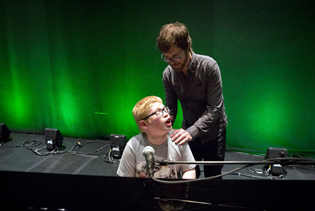 "Musician Ben Folds (right) listens as Ben Schneider sings and plays at Folds' piano following a sound check Thursday, April 14, 2016 at the Majestic Theatre in Dallas. Schneider, 11, who is both blind and autistic, learned to play Folds' song ""Sky High"" and considers the musician a hero. He was given the chance to meet Folds during a VIP event before his show Thursday night."