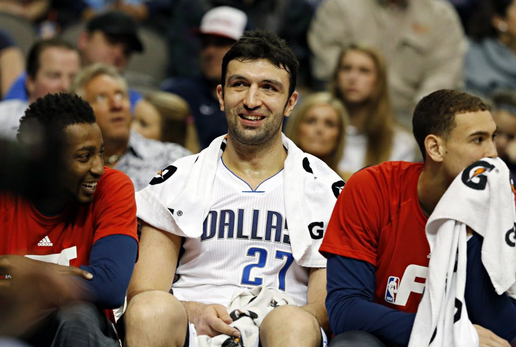 Dallas Mavericks center Zaza Pachulia (center) is all smiles on the bench after his double-double during the second half of Dallas' 91-79 win over the Brooklyn Nets Friday, January 29, 2016 at the American Airlines Center in Dallas. (G.J. McCarthy/The Dallas Morning News)