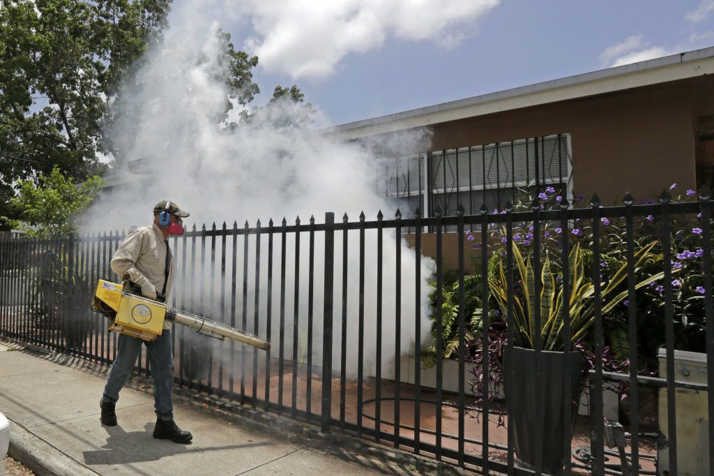 A Miami-Dade County mosquito control worker sprays around a home in the Wynwood area of Miami on Monday. The CDC has issued a new advisory that says pregnant women should not travel a Zika-stricken part of Miami, and pregnant women who live there should take steps to prevent mosquito bites and sexual spread of the virus. (AP Photo/Alan Diaz)