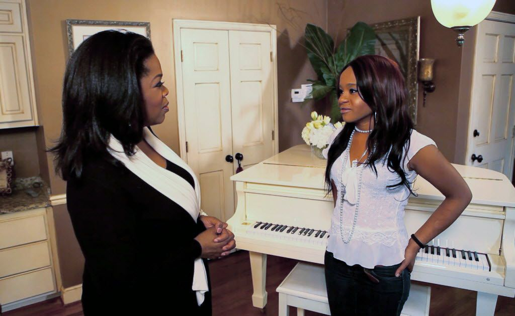 """In this undated image from video released by Harpo, Inc., host Oprah Winfrey, left, is shown with Bobbi Kristina, daughter of the late singer Whitney Houston during an interview in Atlanta, Ga. The exclusive interview will be shown on """"Oprah's Next Chapter,"""" on the OWN network, Sunday, March 11, 2012 at 9:00 p.m. EST. (AP Photo/Harpo, Inc.)"""