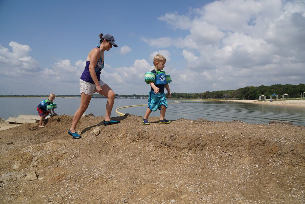 Natalie Jansen and her son's Jacob (5 years old) and Eli (3 years old) enjoy the Labor Day weekend at Joe Pool Lake in Grand Prairie, Texas on September 2, 2016.