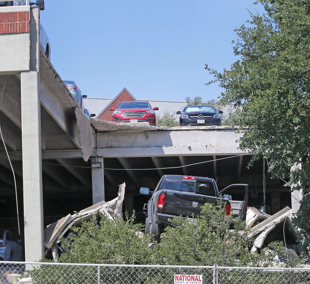 About 20 cars were damaged or destroyed when a parking garage collapsed in Irving, and many more are stuck in the garage.