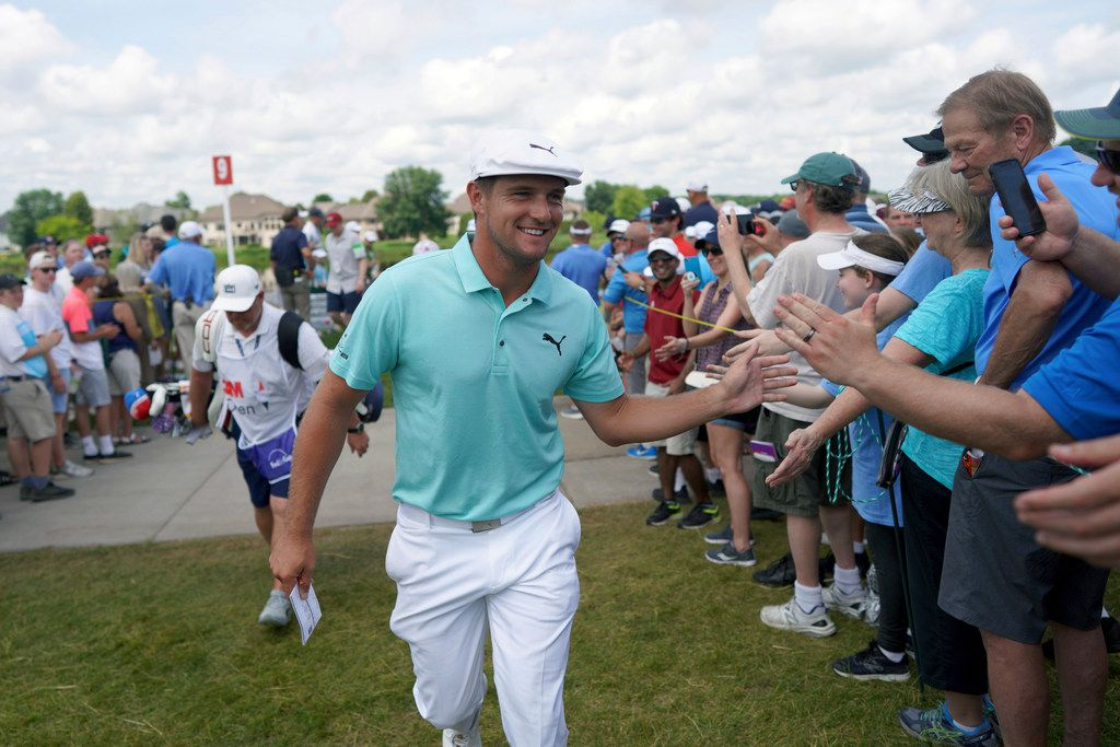 Bryson DeChambeau greets fans as he leaves the ninth hole during the second round of the 3M Open golf tournament in Blaine, Minn., Friday, July 5, 2019. (Jerry Holt/Star Tribune via AP)