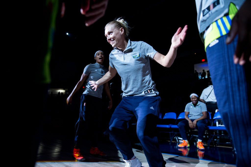 Dallas Wings guard Erin Phillips (31) high five teammates during the pregame ceremony of a WNBA basketball game at College Park Center on June 8, 2016 in Arlington. (Ting Shen/The Dallas Morning News)