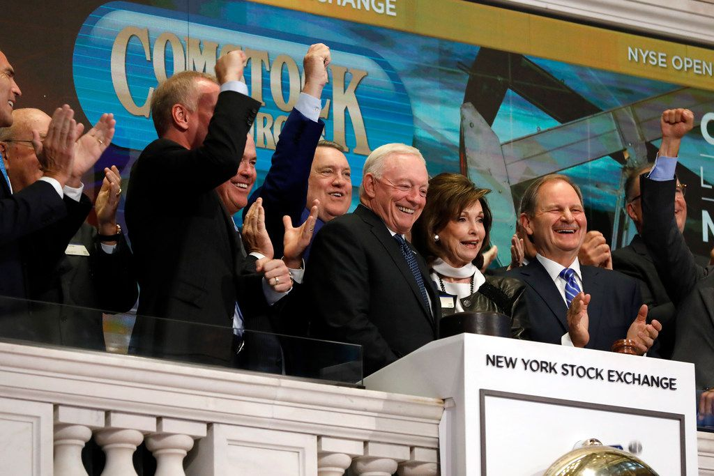 Dallas Cowboys owner and major stockholder of Comstock Resources Jerry Jones, with wife Gene, is applauded as he rings the New York Stock Exchange opening bell, Wednesday, Sept. 4, 2019. The company is celebrating its $2.2 billion acquisition of Covey Park Energy.