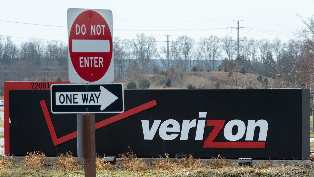 "(FILES) This file photo taken on January 2, 2015 shows the Verizon logo at the headquarters for Northern Virginia in Ashburn, Virginia.  Yahoo said March 13, 2017 that board member and former internet executive Thomas McInerney would lead the business that remains after the sale of its core assets to Verizon is completed. The internet pioneer said the sale of its main operating unit was on track to be completed in the second quarter, and that McInerney would head the financial holding company that remains, provisionally called ""Altbaba.""  / AFP PHOTO / Paul J. RichardsPAUL J. RICHARDS/AFP/Getty Images"