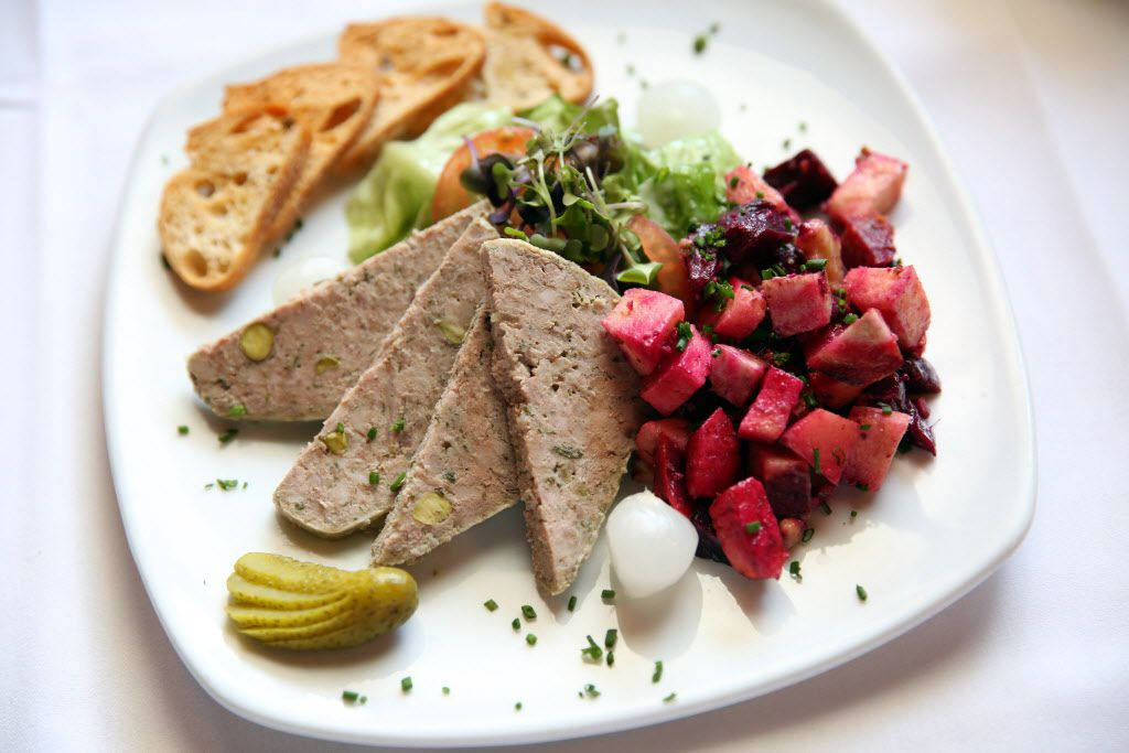 Saint-Emilion 's pistachio-studded house-made duck pate is served with cornichons and a little potato salad. Dining at  Bernard Tronche's 30-year-old restaurant in Fort Worth can feel like a mini-vacation in France -- without the jet lag.