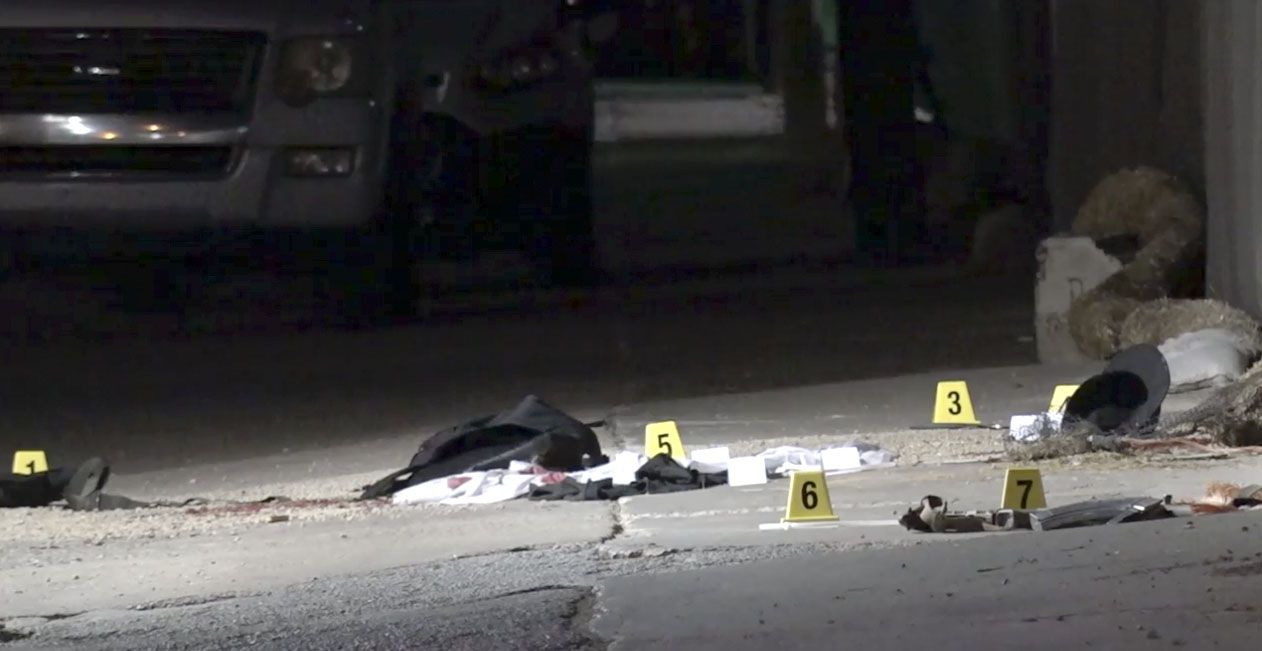 Police evidence markers were set up in the alley behind the Knox-Henderson Apple story in Dallas on Tuesday.