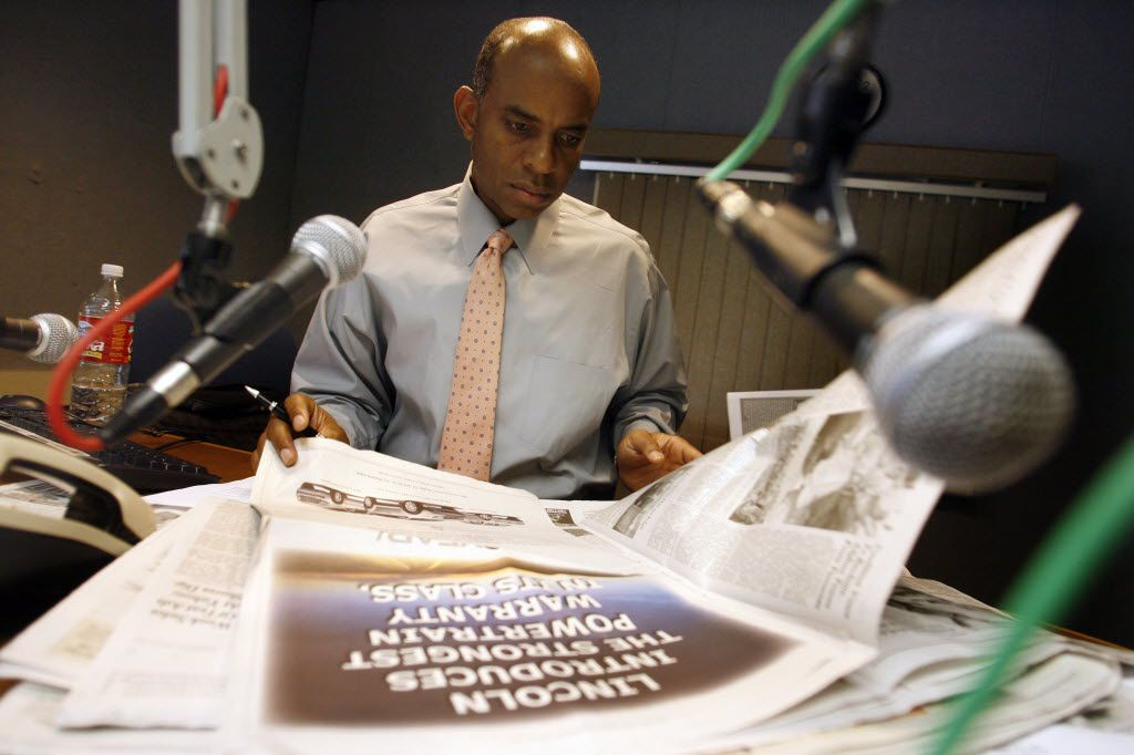 KKDA-AM (730) host Willis Johnson looks through a newspaper during a break on The Willis Johnson Good Morning Show in Grand Prairie in 2006.