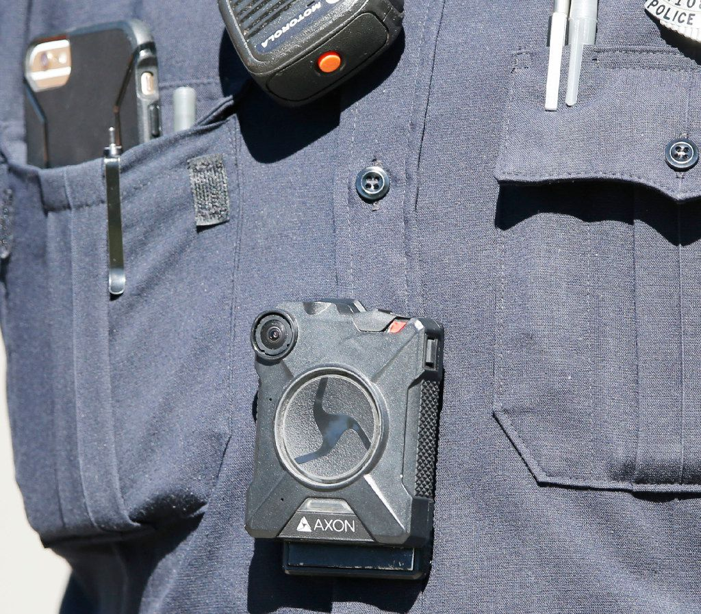 An Axon body camera can be seen on a Dallas police officer at the scene of an active shooter situation at a house on Reynolds Avenue in Old East Dallas on May 1, 2017. (Vernon Bryant/The Dallas Morning News)