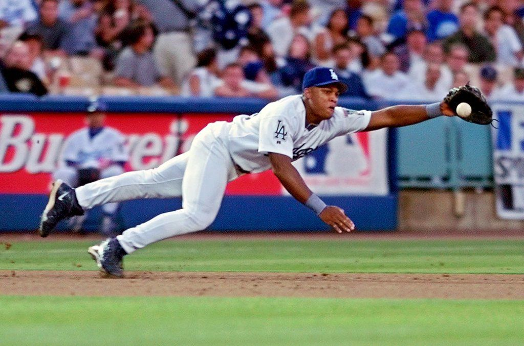FILE - Los Angeles Dodgers' Adrian Beltre dives for a ball hit by Colorado Rockies' Vinny Castilla during the first inning, Wednesday, July 21, 1999, in Los Angeles.  Castilla was safe at first on the play. (AP Photo/Mark J. Terrill)