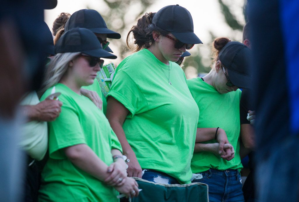 Family and community members gathered for a candlelight vigil in remembrance of 16-month-old Ashton Ness at Wayne Ferguson Plaza on Thursday.