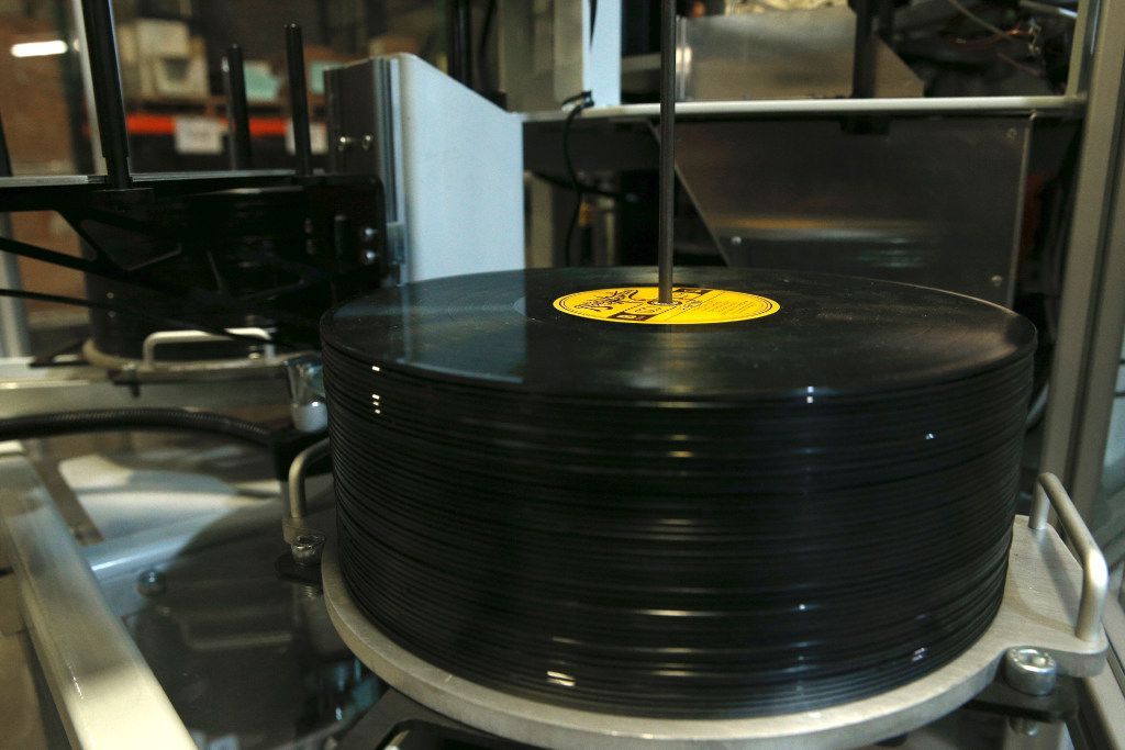 Records sit in a album press at Hand Drawn Pressing in Addison, Texas on January 17, 2017.