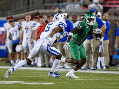 North Texas running back Tre Siggers carries the ball during the Mean Green's loss to SMU on Saturday. Siggers exploded for 164 yards in his first game at running back for UNT.