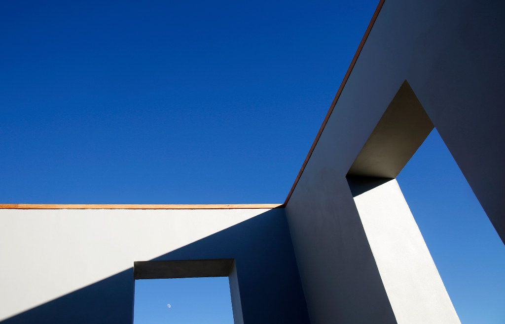 The moon is seen in the late afternoon through one of the openings in an exterior wall of the Robert Irwin, Untitled (dawn to dusk), 2016 permanent installation at the Chinati Foundation in Marfa. (Guy Reynolds/ Dallas Morning News, Courtesy of the Chinati Foundation, © Robert Irwin / Artists Rights Society (ARS), New York)