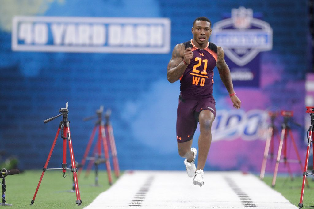 Georgia wide receiver Mecole Hardman runs the 40-yard dash at the NFL football scouting combine in Indianapolis, Saturday, March 2, 2019. (AP Photo/Michael Conroy)