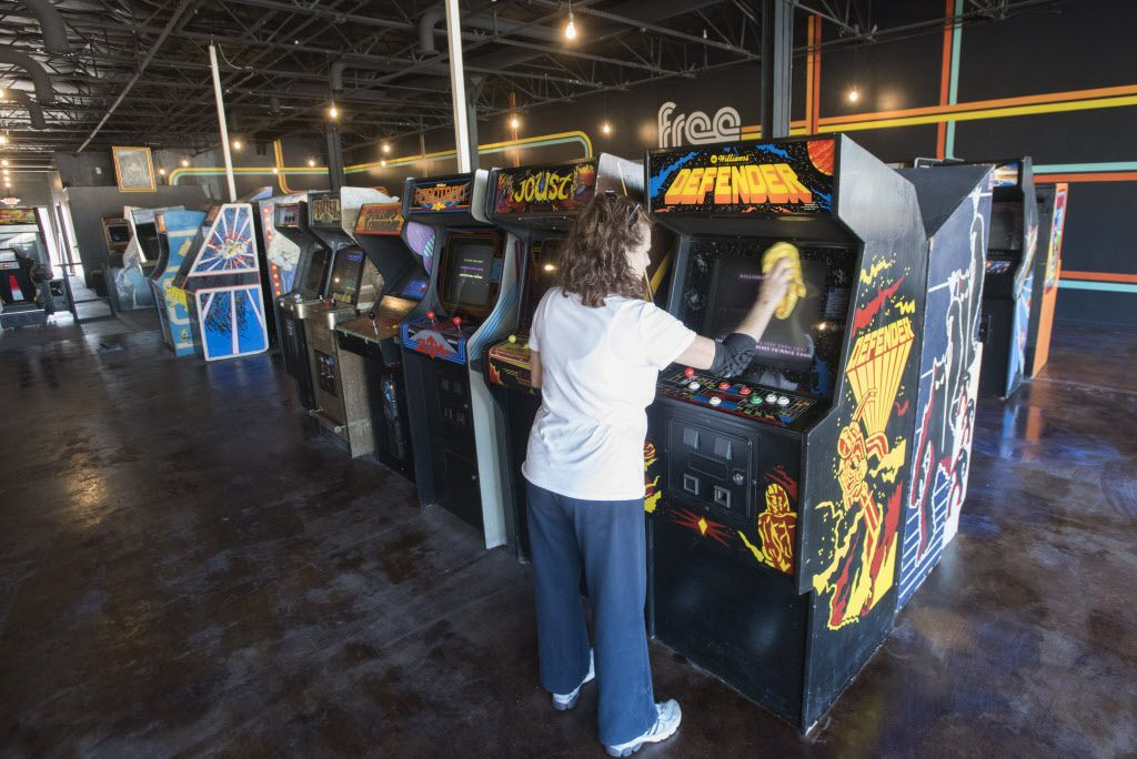 Gayle Wood cleans video games at  Free Play, a retro arcade in Richardson on Friday, Dec. 4, 2015. Her son, Corey Hyden, is one of the owners.  After a $10 cover the games are free.