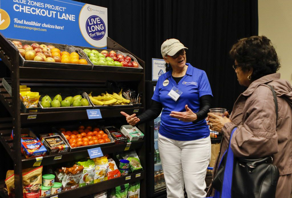 "Sondra Hay (left), who heads up the grocery committee for Fort Worth's ""Blue Zone"" project, talks to Ramona Moreno about an initiative to offer healthier choices in the ""impulse buy"" areas at grocery store checkout aisles during a kickoff event for Fort Worth's ""Blue Zones"" project, a community effort to get residents to eat less, exercise more and get healthy, at the Will Rogers Memorial Center in Fort Worth. (File Photo/The Dallas Morning News)"